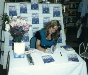 Charlotte Laws signing books